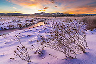The morning twilight opens the skies above the mountains of Canaan Valley in West Virginia revealing a snow and frost laden landscape in the lower valley.