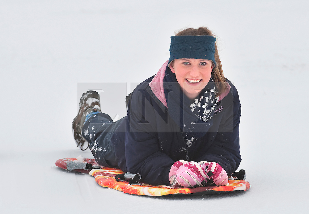 © Licensed to London News Pictures. 05/02/2012. Dunstable, UK. Georgie Callender (Corr) aged 15 sledding on a snow covered Dunstable Downs in Bedfordshire, on February 5th, 2012. Photo credit : Ben Cawthra/LNP