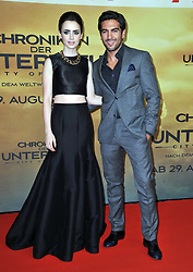 Lily Collins and Elyas M'Barek  arrives for the 'The Mortal Instruments: City of Bones' Germany premiere at Sony Centre on Tuesday August 20, 2013 in Berlin, Germany. Photo by Schneider-Press / John Farr / i-Images. <br /> UK & USA ONLY