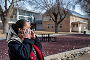 Denise Jensen, a teacher at at Navajo Preparatory School, stands for a portrait on campus in Farmington New Mexico.