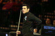 Ronnie O'Sullivan holds his back during his match against Yu De Lu . Betvictor Welsh Open snooker 2016, day 4 at the Motorpoint Arena in Cardiff, South Wales on Thursday 18th Feb 2016.  <br /> pic by Andrew Orchard, Andrew Orchard sports photography.