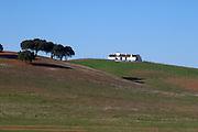 fields and farm house alentejo portugal