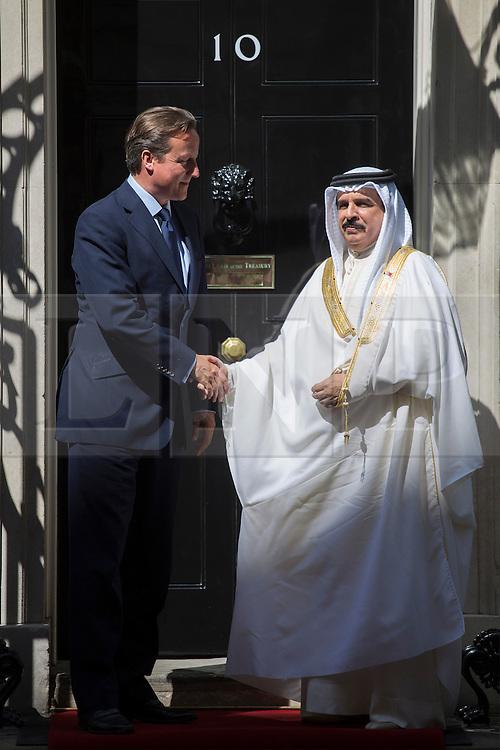 © licensed to London News Pictures. London, UK 06/08/2013. Prime Minister David Cameron meeting King of Bahrain, Hamad bin Isa Al Khalifa on Downing Street on Tuesday, August 08, 2013. Photo credit: Tolga Akmen/LNP