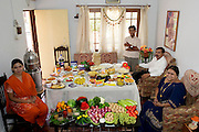 The Patkar family: Jayant, 48, Sangeeta, 42, daughter Neha, 19, and son Akshay, 15 in the living room of their home in Ujjain, Madhya Pradesh, India, with one week's worth of food. From the book Hungry Planet: What the World Eats (Model Released)