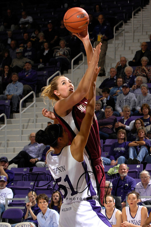 Santa Clara forward Kasey Monteith (24) drives and shoots over Kansas State forward Marlies Gipson (51) in the first half at Bramlage Coliseum in Manhattan, Kansas, December 15, 2006.  K-State defeated Santa Clara 76-52.<br />