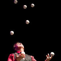 121912       Cable Hoover<br /> <br /> Magician Craig Davis juggles seven balls during his 15th annual performance for the Gallup Firefighters Association Wednesday at El Morro Theatre in Gallup.