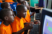 5-6 year olds having a computer lesson at the kindergarten school of the Wema Centre, Mombassa, Kenya. Wema provide a rehabilitation program for street children; poor, disadvantaged youth; and, orphaned and vulnerable children affected by poverty. Emotional support and education enables the children reintegration back into society.
