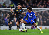 Football - 2018 / 2019 Emirates FA Cup - Fourth Round: Chelsea vs. Sheffield Wednesday<br /> <br /> Chelsea's Willian holds off the challenge from Sheffield Wednesday's Liam Palmer, at Stamford Bridge.<br /> <br /> COLORSPORT/ASHLEY WESTERN