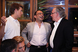 Torvar Mirsky talks with Patrick and Luis Carito at a dinner for skippers and VIPs. Portimao Portugal Match Cup 2010. World Match Racing Tour. Portimao, Portugal. 26 June 2010. Photo: Gareth Cooke/Subzero Images