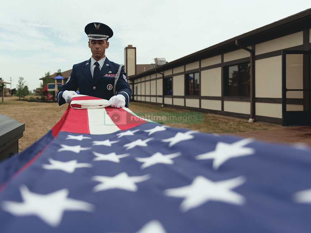 Tech. Sgt. Christopher Mckimmie, a paralegal specialist, and Tech. Sgt. Philip Depronio, an admin specialist, assigned to the 107th Attack Wing, New York National Guard, train on the flag folding portion of funeral honors, Niagara Falls Air Reserve Station, N.Y., July 24, 2018. The triangle folds and all movements involved must be done with precision in order for the flag to be presentable to the next of kin during a service. (U.S. Air National Guard photo by Staff Sgt. Ryan Campbell)