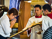 25 MARCH 2016 - BANGKOK, THAILAND: A woman kisses the feet of a statue of Christ during Good Friday observances at Santa Cruz Church in Bangkok. Santa Cruz was one of the first Catholic churches established in Bangkok. It was built in the late 1700s by Portuguese soldiers allied with King Taksin the Great in his battles against the Burmese who invaded Thailand (then Siam). There are about 300,000 Catholics in Thailand, in 10 dioceses with 436 parishes. Good Friday marks the day Jesus Christ was crucified by the Romans and is one of the most important days in Catholicism and Christianity.      PHOTO BY JACK KURTZ