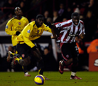 Photo: Jed Wee.<br />Sheffield United v Arsenal. The Barclays Premiership. 30/12/2006.<br /><br />Sheffield United's Christian Nade (R) beats Arsenal's Kolo Toure in the build up to his goal.