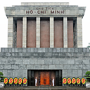 Wide shot of the Ho Chi Minh Mausoleum building. A large memorial in downtown Hanoi surrounded by Ba Dinh Square, the Ho Chi Minh Mausoleum houses the embalmed body of former Vietnamese leader and founding president Ho Chi Minh.