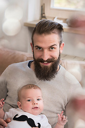 Portrait of father with son