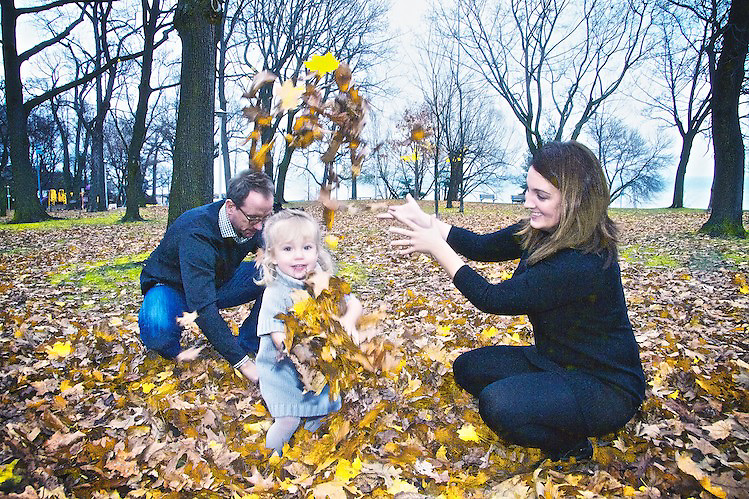 Miller enjoys the autumn leaves with Mom and Dad.<br /> <br /> Film producer Mike Drake and family.