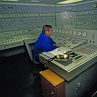 Arctic Ocean, Russia. A technician mans nuclear reactor controls on a Russian icebreaker.
