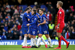 Chelsea's Eden Hazard (second left) celebrates scoring his side's second goal of the game with his team mates during the Premier League match at Stamford Bridge, London.