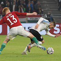 Zsolt Kalmar (L) of Hungary and Brian Rodriguez (R) of Uruguay fight for the ball during the inauguration match of the newly reconstructed Ferenc Puskas Stadium between Hungary and Uruguay in Budapest, Hungary on Nov. 15, 2019. ATTILA VOLGYI