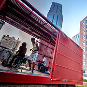 Performance underway by band AY Musik at the Prairie Logic boxcar stage at downtown Kansas City's Power and Light District green roof.