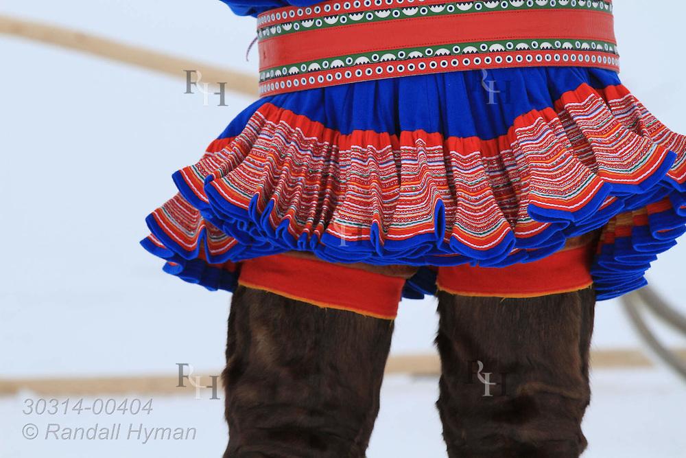 Colorful needlework adorns tunic of traditional Sami folk costume on man in Kautokeino, Finnmark, Norway.