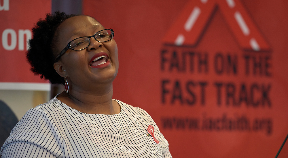 """Liako Lekhooa-Oude Lansink speaks to the July 21 opening session of """"Faith Building Bridges"""" in Amsterdam, the Netherlands. The July 21-22 interfaith event, sponsored by the World Council of Churches-Ecumenical Advocacy Alliance was held on the eve of the 2018 International AIDS Conference. Lansink is from Shiva."""