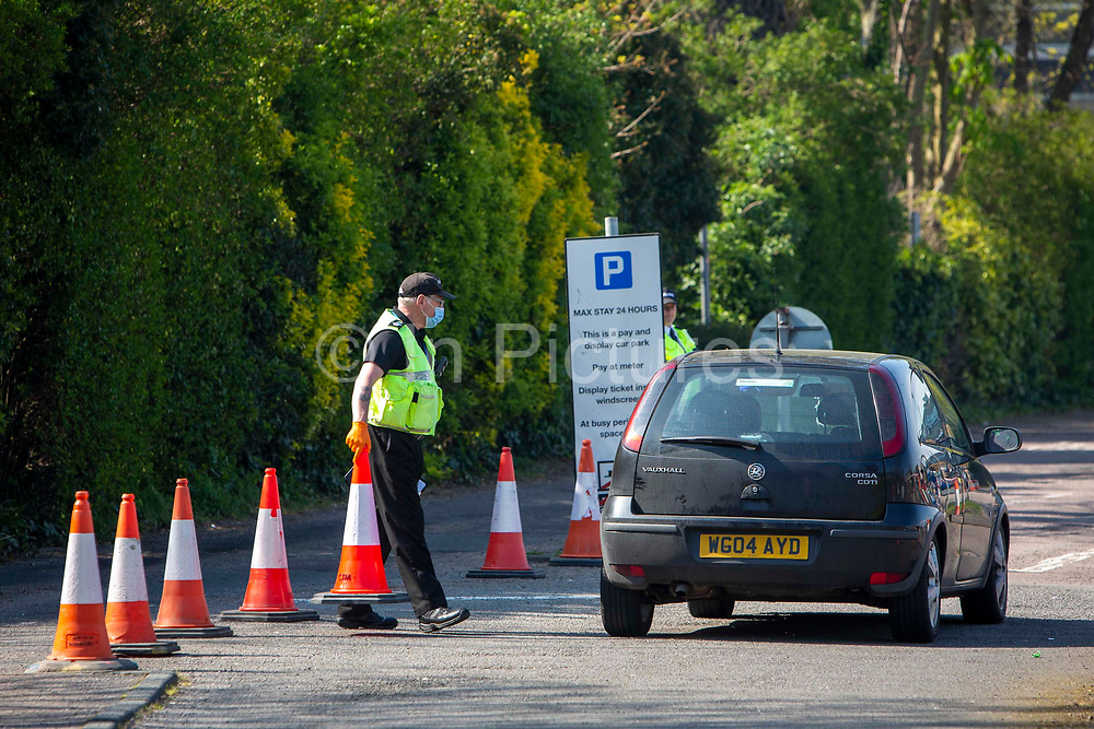 Patients arrive by car through security to see NHS staff at a Primary Care Clinical Assessment Centre where potentially infectious and symptomatic Coronavirus patients can be assessed and treated by a doctor or a nurse, in a safe site, on the 16th of April 2020 in Dover, United Kingdom. This is not a COVID-19 testing facility, all patients will only be clinically assessed on site as there is no community testing currently available. All patients have been referred to this centre by NHS 111 or their GP.
