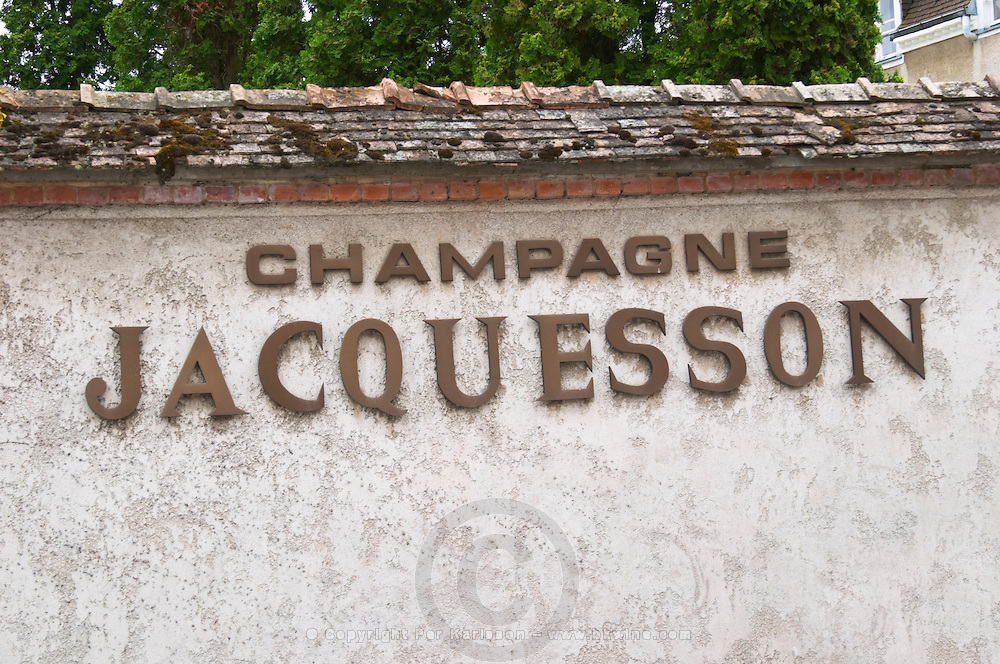 A wall with brass letters indicating that this is the winery, Champagne Jacquesson in Dizy, Vallee de la Marne, Champagne, Marne, Ardennes, France