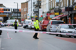 © Licensed to London News Pictures. 30/10/2020. London, UK. A police officer guards a crime scene on West Green Road in Tottenham, north London, following the stabbing of a man in his 20s. Photo credit: Dinendra Haria/LNP