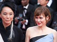 Director Naomi Kawase and Actress Marie-Josee Croze at the gala screening for the film The Unknown Girl (La Fille Inconnue) at the 69th Cannes Film Festival, Wednesday 18th May 2016, Cannes, France. Photography: Doreen Kennedy