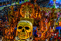 "Floats in the Carnaval parade of Estacio de Sa samba school in the Sambadrome, Rio de Janeiro, Brazil.            The theme  of their parade is ""Stones"" which includes a 2001:A Space Odyssey type scene with cavemen watching a rock open into a spacecraft with astronauts coming out."