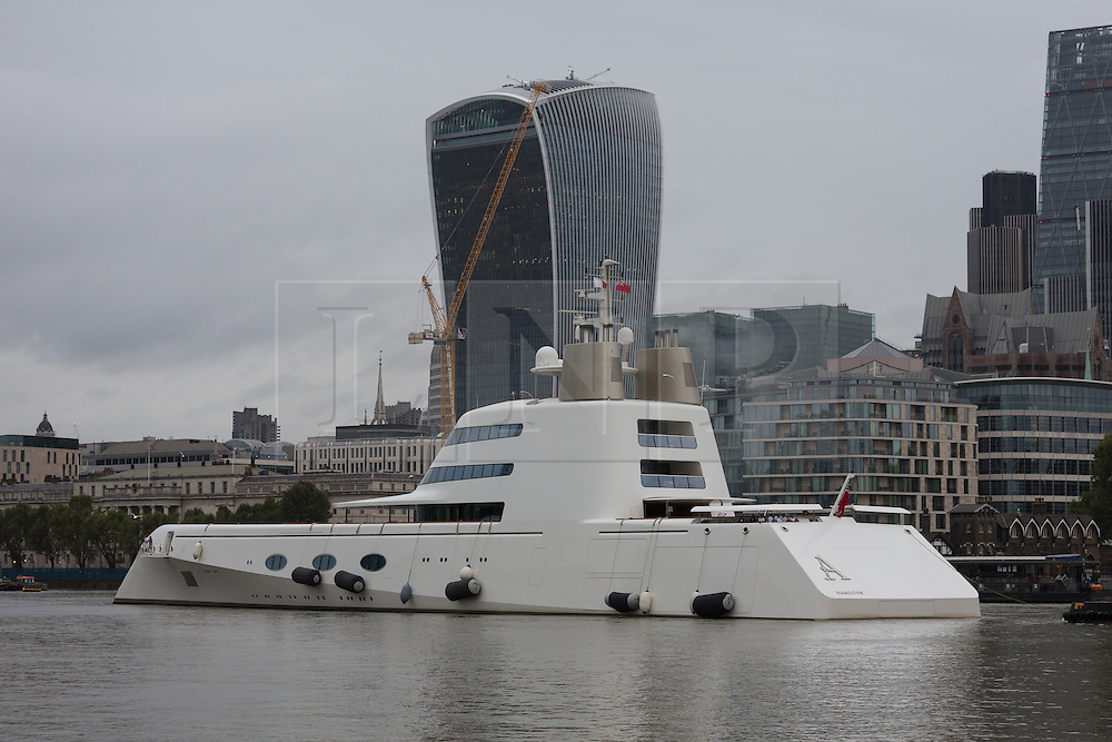 © Licensed to London News Pictures. 10/09/2016. LONDON, UK.  Motor Yacht A leaves London passing 'The Walkie-Talkie' skyscraper before going under Tower Bridge on the River Thames early this morning. The £225m superyacht, owned by Russian billionaire, Andrey Melnichenko (known as the King of Bling) has spent the last week moored next to HMS Belfast during a London visit. Motor Yacht A is 390ft long, was designed by Philippe Starck, inspired by a submarine and is now reported to be up for sale because Melnichenko is building a new superyacht.  Photo credit: Vickie Flores/LNP