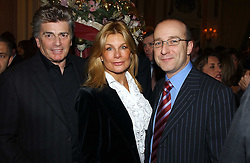 Left to right, ASHLEY BRODIN, his wife model JILLY JOHNSON and MR PAUL McKENNA at The Business Winter Party hosted by Andrew Neil at The Ritz Hotel, Piccadilly, London on 7th December 2005.<br /><br />NON EXCLUSIVE - WORLD RIGHTS