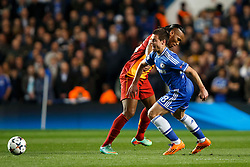 Galatasaray Forward Didier Drogba (CIV) is is tackled by Chelsea Defender Cesar Azpilicueta (ESP)  - Photo mandatory by-line: Rogan Thomson/JMP - 18/03/2014 - SPORT - FOOTBALL - Stamford Bridge, London - Chelsea v Galatasaray - UEFA Champions League Round of 16 Second leg.