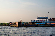 Boats sit outside of the floating village of Kampong Phluk, Cambodia.
