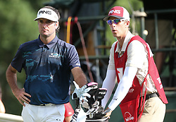June 21, 2018 - Cromwell, Connecticut, United States - CROMWELL, CT-JUNE 21: Bubba Watson (L) and his caddie Ted Scott wait on the 18th tee during the first round of the Travelers Championship on June 21, 2018 at TPC River Highlands in Cromwell, Connecticut. (Credit Image: © Debby Wong via ZUMA Wire)