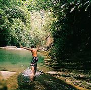 A man jumping into a pool of water at the Edward James Surrealist Gardens at Las Pozas, Xilitla, Mexico