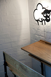 Old-fashioned Desk and Animal Shape Wall Lamp