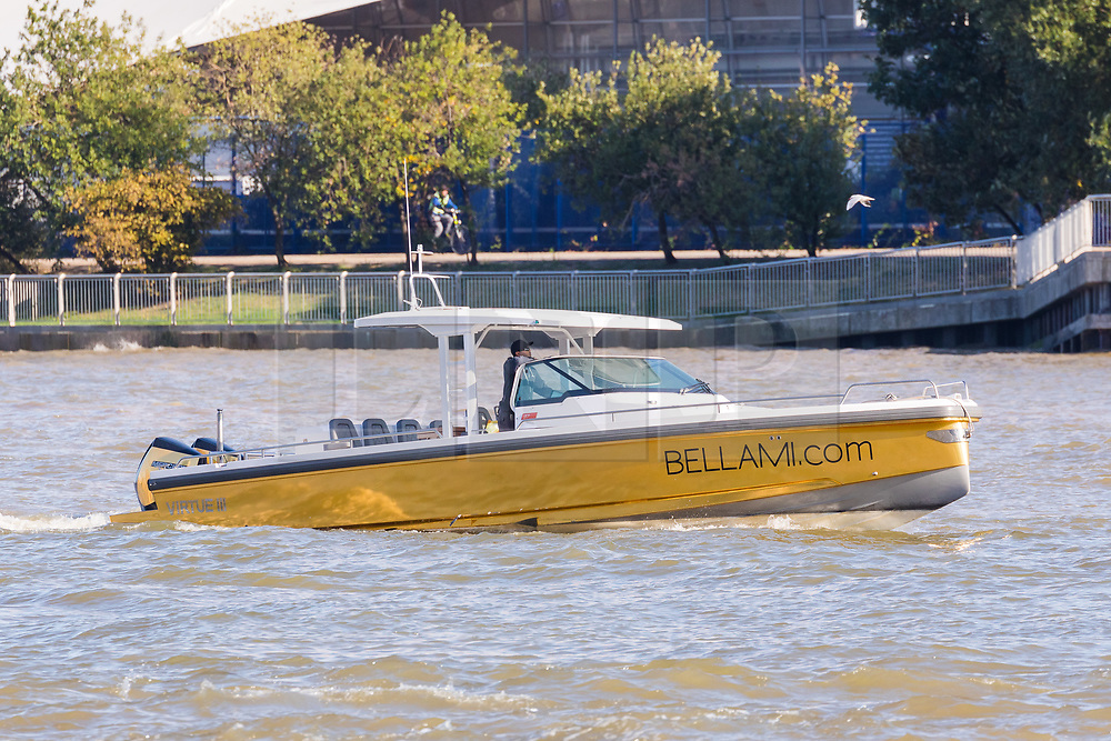© Licensed to London News Pictures. 17/09/2019. London, UK. The tender boat belonging to gold wrapped, 175 feet long superyacht, Bellami.com arrives in London on the River Thames before mooring in East India Dock. It took 13 days and 600sqm of gold chrome vinyl wrap to cover the superyacht formally known as 'Kinta' at the Port of Viareggio in Italy this year and is the largest chrome yacht wrap done fully in the water and possibly the largest chrome wrap ever. As Bellami.com arrived, it was noticed that some of the chrome wrap was already damaged and missing. Photo credit: Vickie Flores/LNP