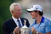 RORY MCILROY and former champion KEN VENTURI with the trophy after winning the 111th U.S Open Golf Championship in Bethesda, MD. MCILROY shot a 2-under round on the final day to finish at 16-under par and win his first major.