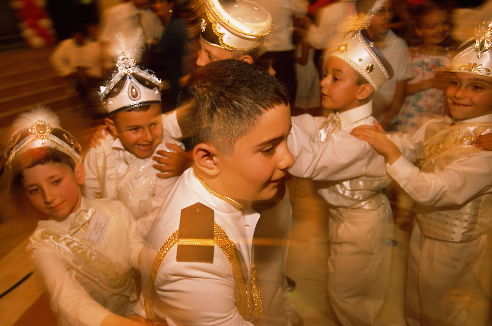 Boys about to be circumcised at Kemal Özkan's Circumcision Palace in Istanbul, Turkey, play games together. This is one of the many activities used to make the boys relax before the actual circumcision takes place. As custom dictates, the boys are dressed up as small sultans or princes.