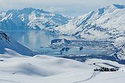 Snowmobilers above the township of Valdez, Alaska, USA. MRA
