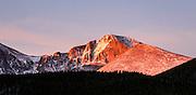 Longs Peak lit up at sunrise.