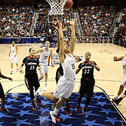 Gabby Williams, UConn, rebounds while challenged by Marley Hill, Cincinniti, during the UConn Vs Cincinnati Quarterfinal Basketball game at the American Women's College Basketball Championships 2015 at Mohegan Sun Arena, Uncasville, Connecticut, USA. 7th March 2015. Photo Tim Clayton