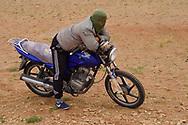 Mongolian Shepherd and his motorbike, Inner Mongolia, China