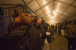 """Maria Maltsevam, a rider with The Thundering Cossack Warriors, shares a kiss with one of the horses before a performance. <br /> Ringling Bros. and Barnum & Bailey Circus started in 1919 when the circus created by James Anthony Bailey and P. T. Barnum merged with the Ringling Brothers Circus. Currently, the circus maintains two circus train-based shows, the Blue Tour and the Red Tour, as well as the truck-based Gold Tour. Each train is a mile long with roughly 60 cars: 40 passenger cars and 20 freight. Each train presents a different """"edition"""" of the show, using a numbering scheme that dates back to circus origins in 1871 — the first year of P.T. Barnum's show."""