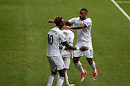 Tammy Abraham of Swansea city (10) celebrates with teammates Tom Carroll and Luciano Narsingh (r) after he scores his teams 1st goal. Premier league match, Swansea city v Huddersfield Town at the Liberty Stadium in Swansea, South Wales on Saturday 14th October 2017.<br /> pic by  Andrew Orchard, Andrew Orchard sports photography.