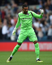Millwall goalkeeper Jordan Archer celebrates as his side score their first goal