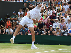 July 9, 2018 - London, England, U.S. - LONDON, ENG - JULY 09: Stefanos Tsitsipas (GRE) serving during his fourth round on July 9, 2018match at the Wimbledon Championships, played at the All England Lawn Tennis and Croquet Club in London, England. (Photo by Cynthia Lum/Icon Sportswire (Credit Image: © Cynthia Lum/Icon SMI via ZUMA Press)