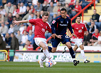Photo: Leigh Quinnell.<br /> Bristol City v Nottingham Forest. Coca Cola League 1. 31/03/2007. Bristol Citys Brian Wilson holds off Forests James Perch.