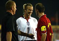 Photograph: Scott Heavey.<br />England v Macadonia at the City Stadium in Skopje, Macadonia. 05/09/2003.<br />David Beckham enjoys winding the Macadonian captain Sakiri Artim.
